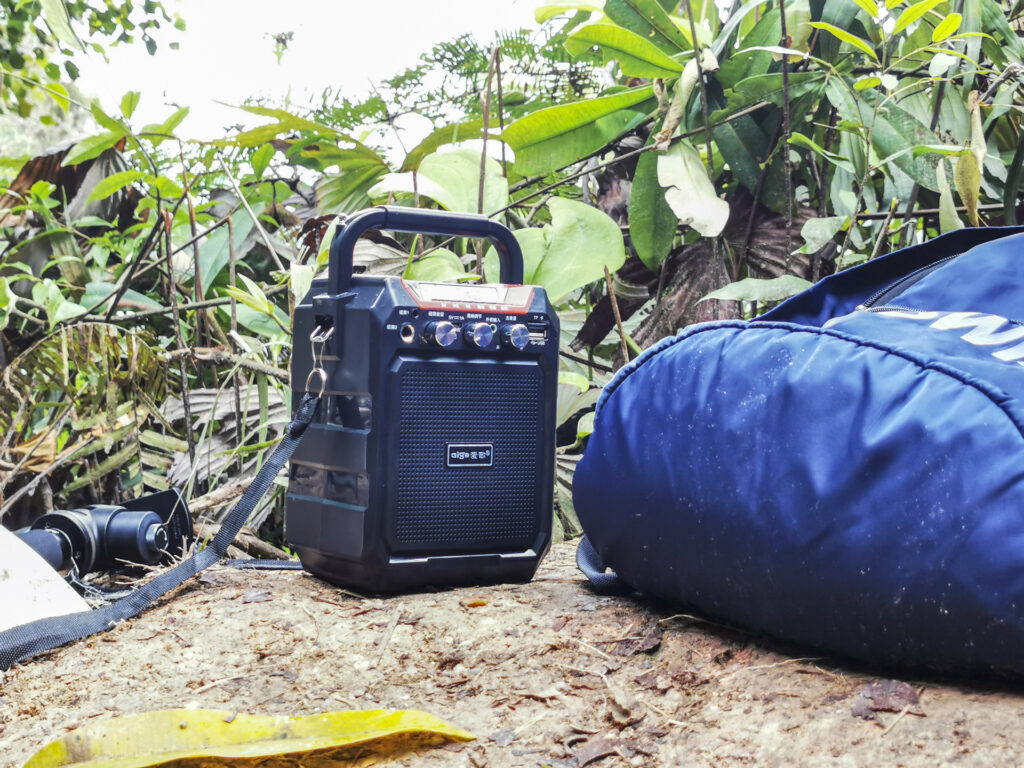 A portable speaker placed on the ground and playing recorded playbacks to lure the hornbill.
