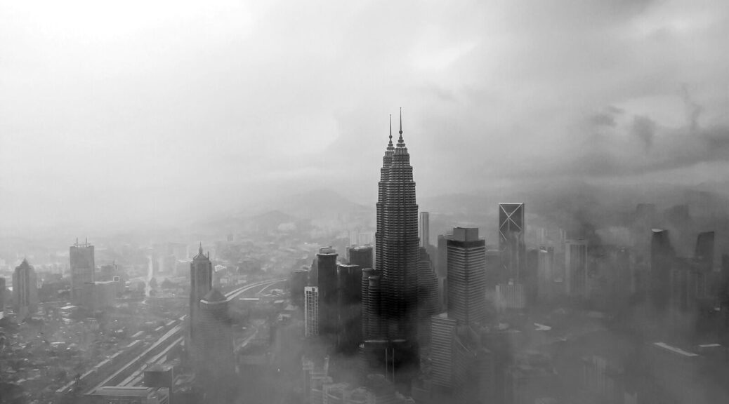 Mist rising above Kuala Lumpur Twin Towers.